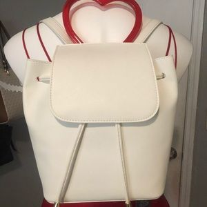 White backpack with heart handle